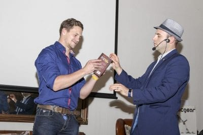 Magician Greg Gelb fascinates an audience at a corporate golf day. | Photo Credit: Gavin Withers Photography