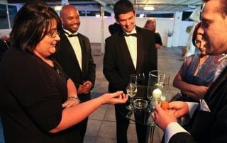 Magician Marcel Oudejans performing for the guests of a wedding reception