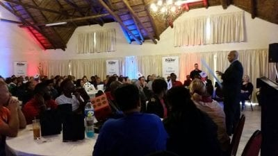 Andrew 'Magic Man' Eland performing at a team building event for AutoTrader