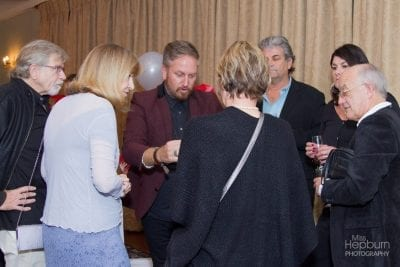"""""""Magician Insane"""" Russell Fox delights guests at a charity fundraiser show. 