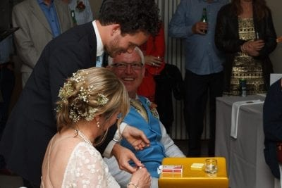 Magician Jesse Brooks delights the bridal couple at their wedding.
