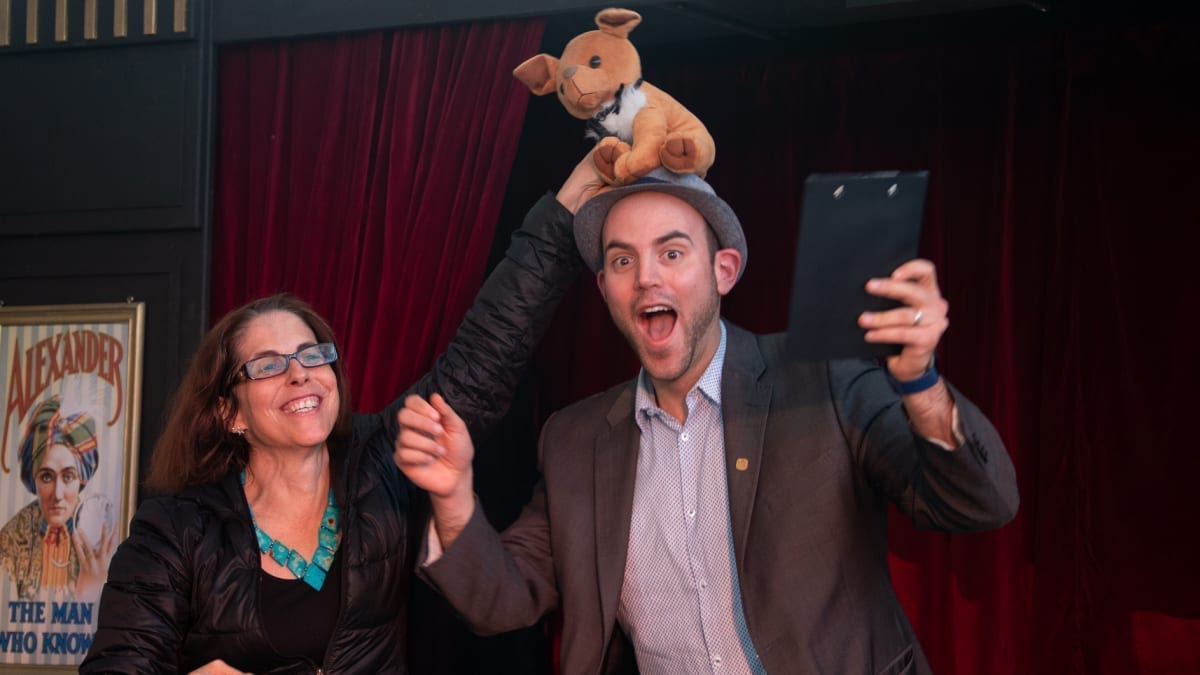 Magician Greg Gelb proves, with the help of volunteer Robyn Cohen, that sometimes you can't plan what's going to happen in a show! [Photo credit: Andrew Gorman]
