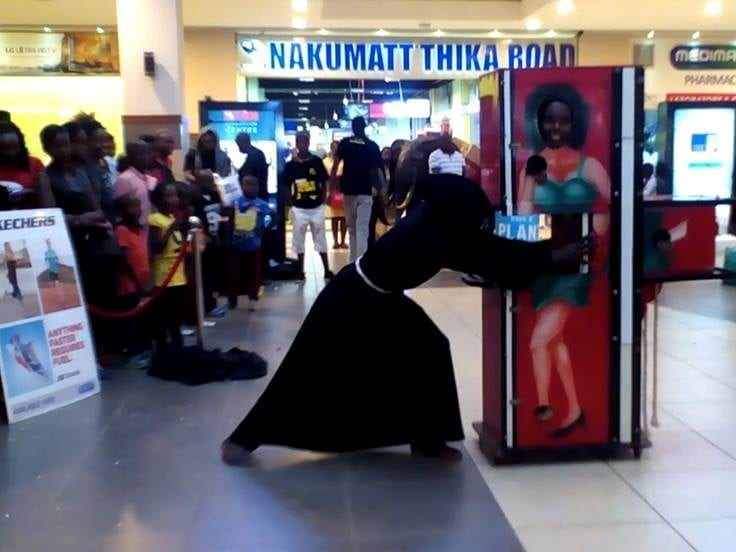 Kenyan Illusionist Mchawi entertains the public at a product launch roadshow