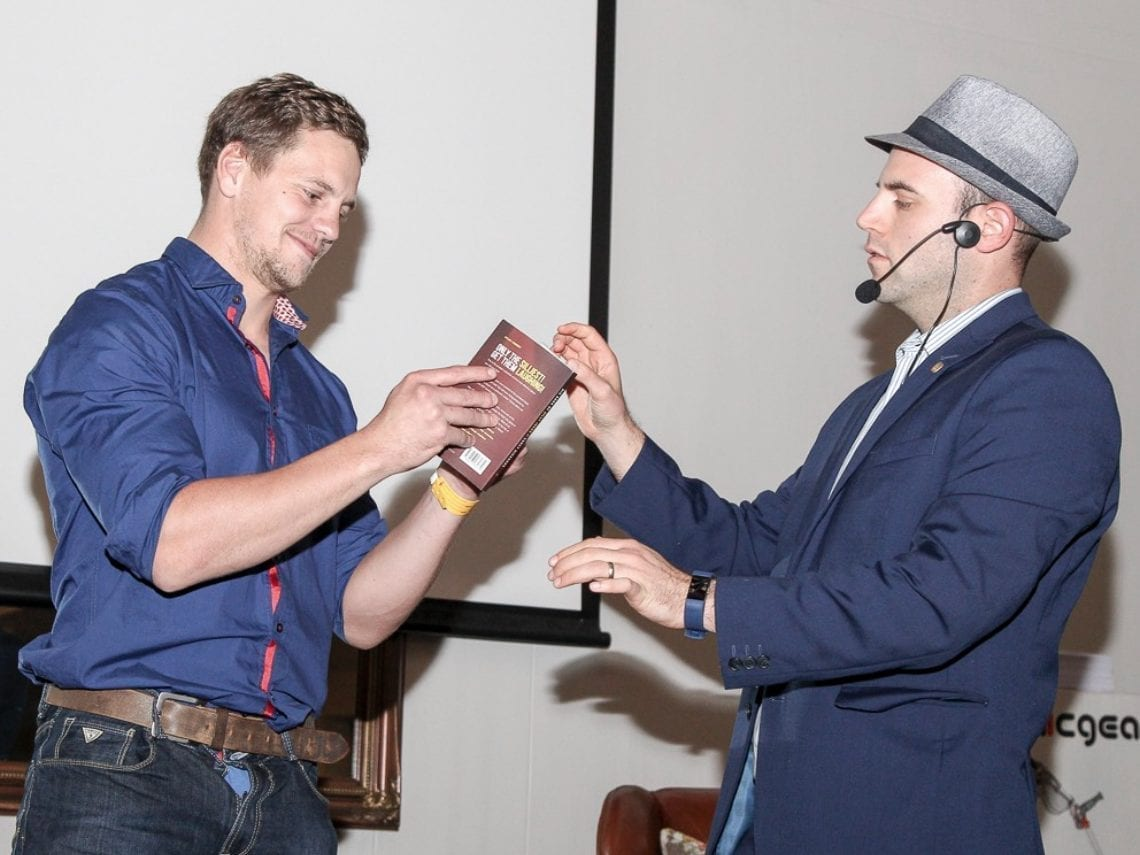 Comedy Magician Greg Gelb amazes an on-stage volunteer