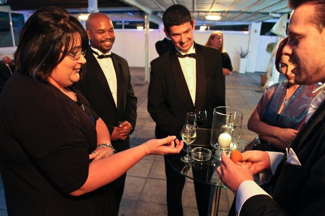 Wedding guests are entertained by magician Marcel Oudejans