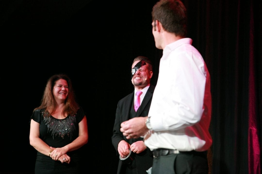 Corporate magician Marcel Oudejans being blindfolded by audience members